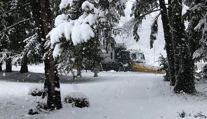 Staff  PhillyVoiceAn Upper Dublin snow plow is seen through a snowy path as it clears a cul-de-sac on Wednesday afternoon