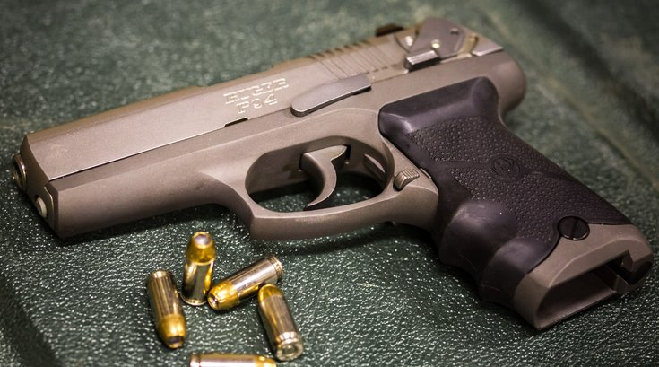 Stock_Carroll - Handgun with Bullets