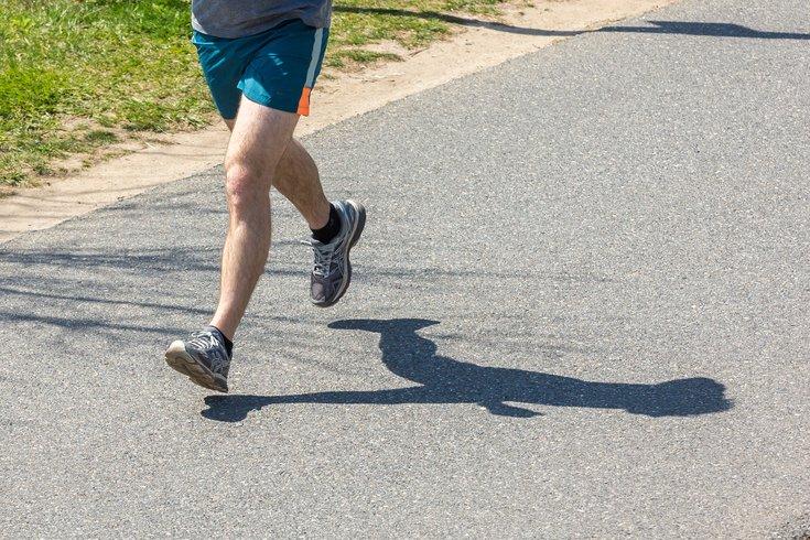 Stock_Carroll - Running on the Schuylkill River Trail in Philadelphia.