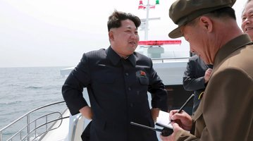 Kim Jong watches missile launch