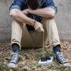 Carroll - Man praying with rosary beads