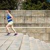 Woman running up steps in Philadelphia
