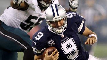 091915_Romo-Graham-Sack_AP