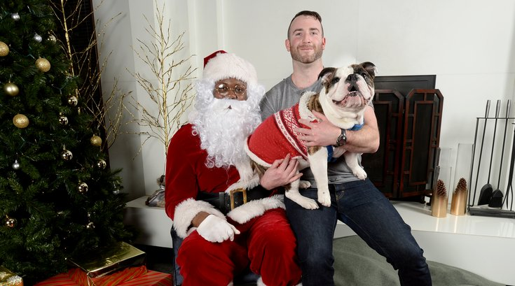 Pets pose for photos with Santa