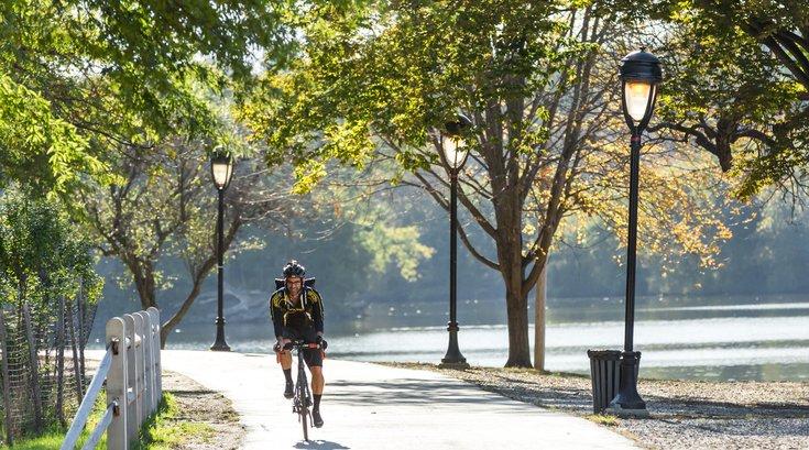 Riding Bike Along River Banks