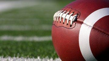 Football on Field Stock