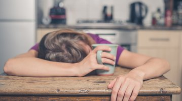 Tired Woman Drinking Tea