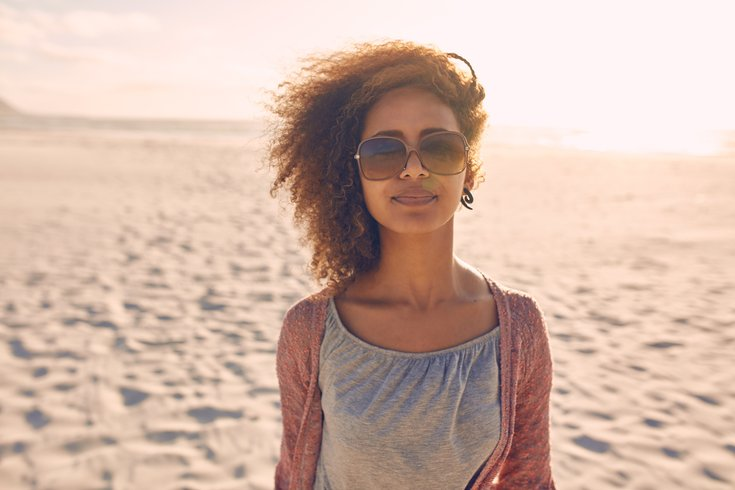 Woman with sunglasses on beach
