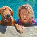 Dog and owner in pool