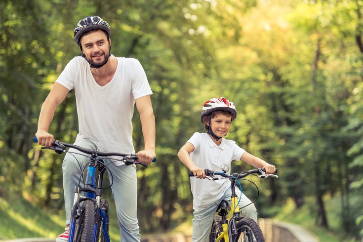 Father and son riding bikes