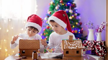 Kids with gingerbread house