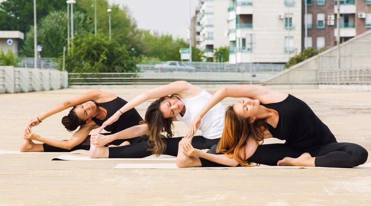 Yoga outside in city