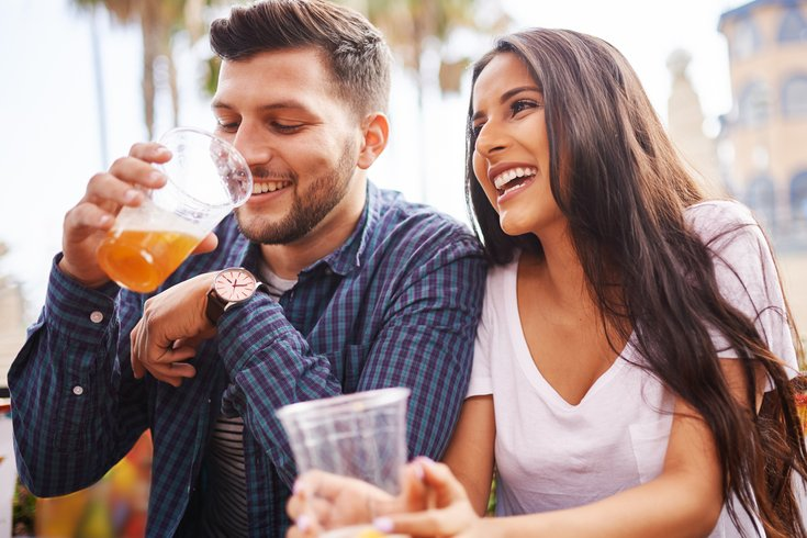 couple drinking beer outside