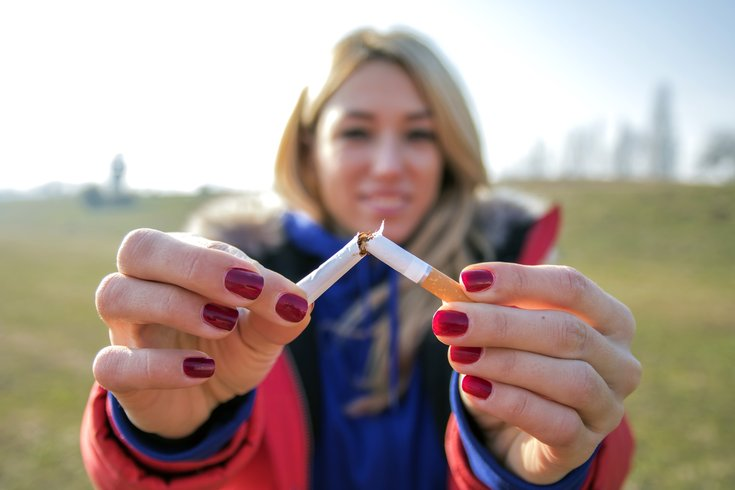 Limited - woman breaking a cigarette in half