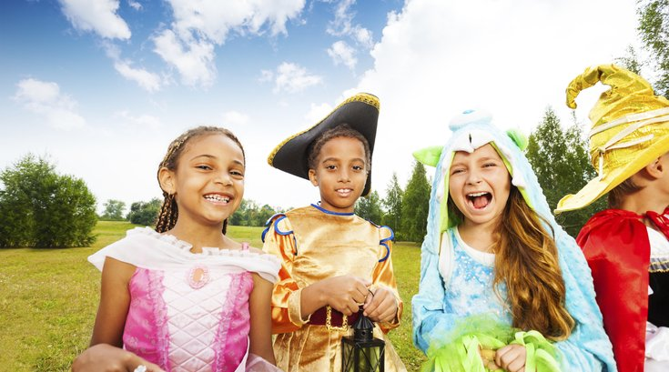 kids in costumes outside