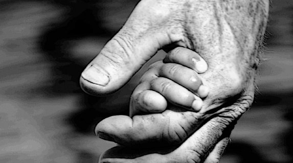 Elderly gentleman and child holding each other's hands