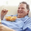 Fat man with chips
