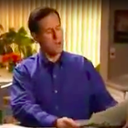 Rick Santorum reads the newspaper