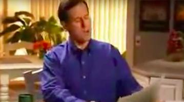 Rick Santorum reads the newspaper