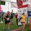 Tim crosses the finish line