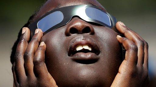 APTOPIX US Eclipse Schools