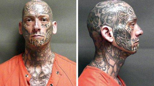Heavily Tattooed Fugitive